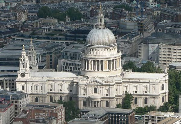 St. Paul's Cathedral. Seat of the Anglican Church in London. The American Memorial Chapel is located inside on the right of the photo. All the stained glass windows were blown out during the WWII blitz. They were replaced with clear glass with the exception of the American section which was re- placed with stained glass of American scenery. Photo: courtesy of St. Paul's.